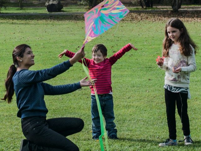 A family playing with a kite