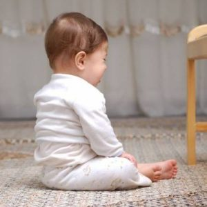 A baby sat on the floor