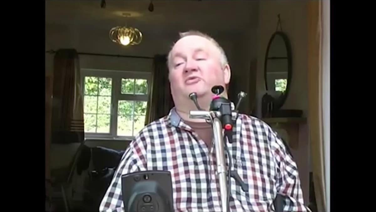 Martin in his wheelchair in a checked shirt