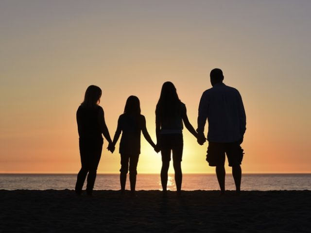 Family of woman and man with two daughters aged 6 and 13