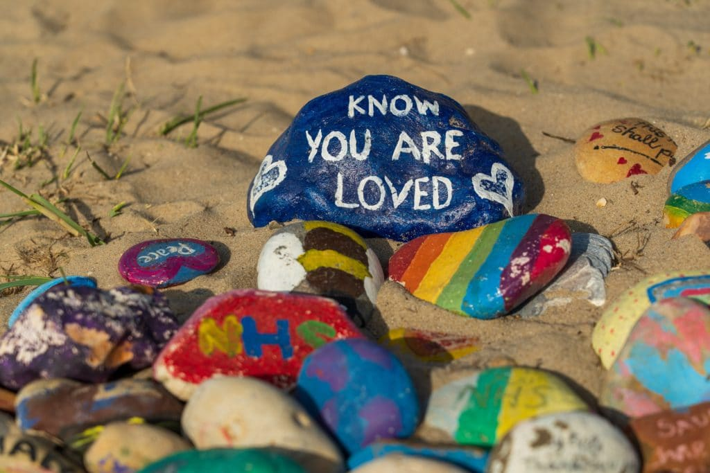 Know you are loved written on a stone
